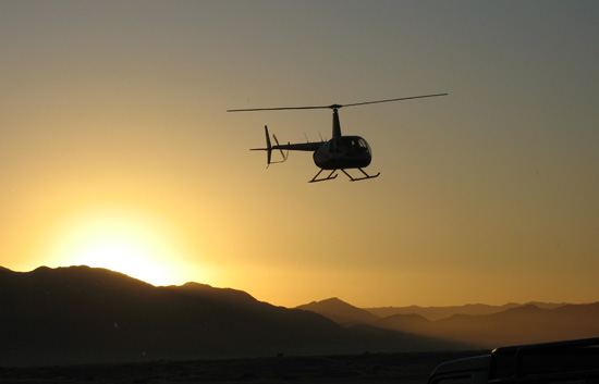 Helicopter flips at sunset